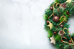 Advent christmas door wreath with festive decoration. Holidays new year concept. Advent christmas door wreath with festive decoration on a cozy background. Copy stock photos