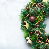 Advent christmas door wreath with festive decoration. Holidays new year concept. Advent christmas door wreath with festive decoration on a cozy background. Copy royalty free stock photo