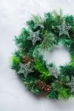 Advent christmas door wreath with festive decoration. Holidays new year concept. Advent christmas door wreath with festive decoration on a cozy background. Flat royalty free stock images
