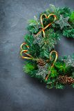Advent christmas door wreath with festive decoration. Holidays new year concept. Advent christmas door wreath with festive decoration on a cozy black background royalty free stock photos