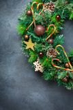 Advent christmas door wreath with festive decoration. Holidays new year concept. Advent christmas door wreath with festive decoration on a cozy black background royalty free stock image