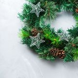 Advent christmas door wreath with festive decoration. Holidays new year concept. Advent christmas door wreath with festive decoration on a cozy background. Copy stock photography