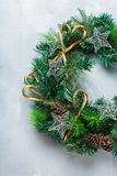 Advent christmas door wreath with festive decoration. Holidays new year concept. Advent christmas door wreath with festive decoration on a cozy background. Flat stock photo