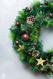 Advent christmas door wreath with festive decoration. Holidays new year concept. Advent christmas door wreath with festive decoration on a cozy background. Flat royalty free stock photos