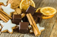 Advent and Christmas food, chocolates, star biscuits, cinnamon, nuts and orange slices stock photos