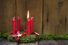 Advent or christmas wreath with four red wax candles. Advent or christmas wreath with four red wax candles on wooden background royalty free stock images