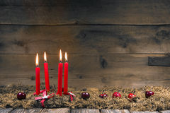 Advent or christmas wreath with four red wax candles. Advent or christmas wreath with four red wax candles on wooden background royalty free stock image