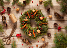 Advent Christmas wreath with natural decorations, pine cones spruce, nuts, candied fruit on wooden rustic background. Advent Christmas wreath with natural stock image