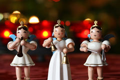 Advent Concert. Three decoration angels making music in front of Advent wreath lights stock photo