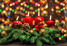 Advent decoration with burning candles and colorful lights Stock Photography
