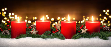 Advent decoration with four burning candles Royalty Free Stock Photography