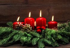 Advent decoration with four red burning candles Royalty Free Stock Photos