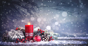Advent decoration with one burning candle Stock Images