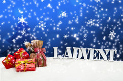 1. Advent - gifts - blue - Snow. Christmas Stock Images
