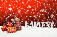 1. Advent - gifts - red - Snow. Christmas Royalty Free Stock Photo