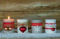 Advent Season, one burning candle on snow. Christmas decoration with one burning Advent candle Stock Photography