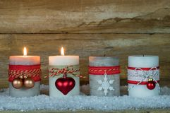 Advent Season, two burning candles on snow Royalty Free Stock Photo