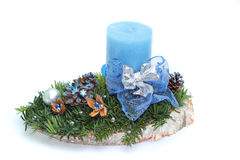 Advent spray with blue candle on white background Royalty Free Stock Photo
