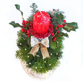 Advent spray with red candle, golden ribbon and holly branch wit. H berries, isolated on white stock photo
