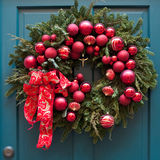 Advent wreath. On green door Stock Photos