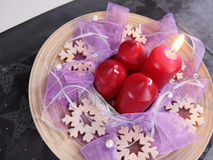 Advent wreath. Christmas advent wreath in lila with red candles Royalty Free Stock Photography