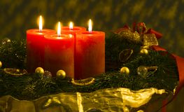 Advent wreath /2. Beautifully decorated Christmas wreath with 4 burning candles. Focus on the front candle / front decoration. Canon 5D, Sigma 2,8 / 150, raw Royalty Free Stock Photos