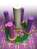 Advent Wreath. A lit advent wreath sits on a purple cloth, the color of the Advent season stock illustration