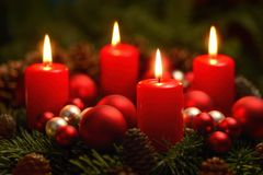 Advent wreath with 4 burning candles Stock Photo