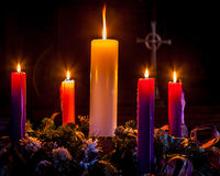 Advent Wreath. Advent candles glow and mark the celebration of Christmas Royalty Free Stock Photography