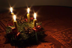 Advent wreath with candles on the round table. Advent wreath with burning candles on the round table Royalty Free Stock Photo