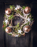 Advent wreath with Christmas deco and four candles Stock Photos