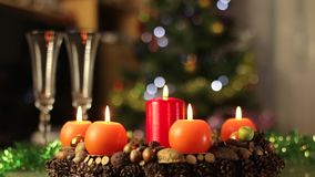 Advent wreath, christmas wreath, candles burning motion. Advent wreath, christmas wreath, two candles burning stock video footage