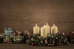 Advent wreath or crown with christmas gifts for a voucher. Royalty Free Stock Image