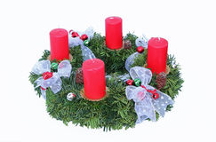 Advent wreath with four candles and silver ribbon. Advent wreath with four red candles and silver ribbon, handicraft work Stock Photos
