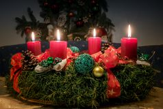 Advent wreath with four lighted red candles Royalty Free Stock Photography