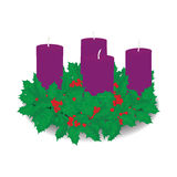 Advent wreath. With four purple candles and holy Stock Photos