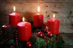Advent wreath from fresh fir tree branches with four red burning Stock Photo