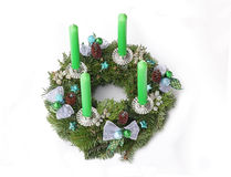 Advent wreath with green candles, turquoise stars and silver rib. Bon, cones and juniper with berries Royalty Free Stock Photography