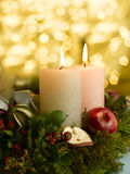 Advent wreath with a lighted candle Stock Photo