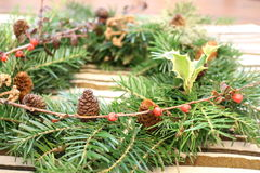 Advent wreath. Making a Christmas garland for the holidays Royalty Free Stock Image