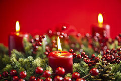 Advent wreath over red background Royalty Free Stock Images