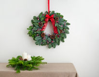 Advent wreath over side board with present Royalty Free Stock Image