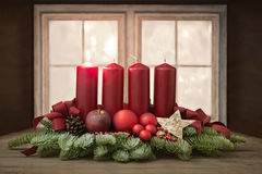 Advent wreath. With red candles in front of a window stock photography