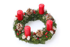 Advent wreath with red candles, natural decoration. Made of cones, ilex and rose hip, silver glittering and beautiful ribbon Royalty Free Stock Image