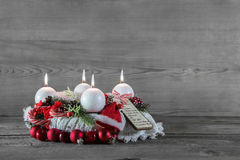 Advent wreath in red and white with four burning candles. Stock Image