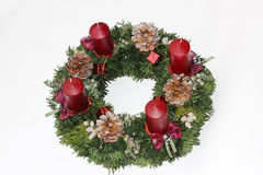 Advent wreath with ruby red candles and silver glittering cones. Juniper with berries and beautiful ribbon Stock Images