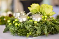 Advent Wreath with silver candles on the spruce branches. With green roses and green christmas balls Royalty Free Stock Photos