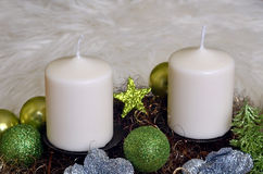 Advent wreath with white candles. And glittery christmas balls Royalty Free Stock Image