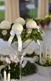 Advent Wreath with white candles on the spruce branches. With silver christmas balls in a large glass vase Royalty Free Stock Photography