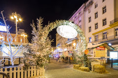 Advent in Zagreb, Croatia. Festive decorated Christmas fair and fast food stands in Zagreb Central Square of Ban Jelacic. ZAGREB, CROATIA ON 28 DECEMBER 2016 stock photography